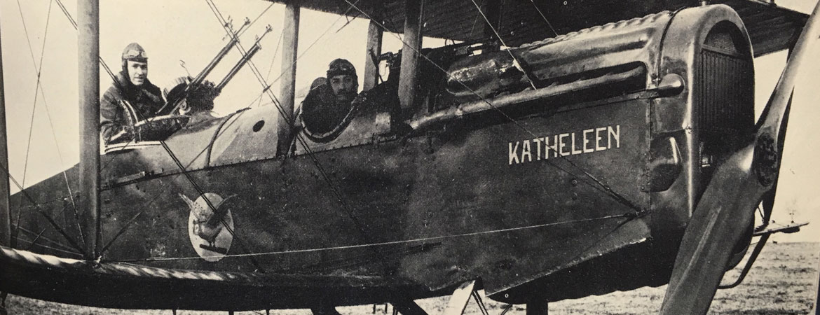 Photo of 2 men in an old aircraft