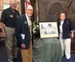 Life member Miles Watkins and his wife, Hereditary member Margaret Ramey Watkins present a picture of her father and founder, Howard K Ramey